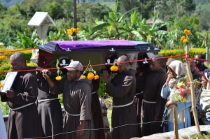 Capuchin Friars carry the casket of their brother, Father Dominic Mc Guinness, OFM Cap.